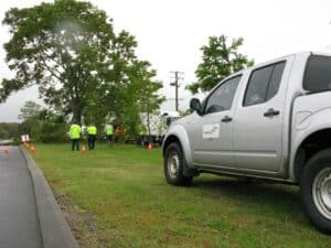 Four supervisors, eight workmen, and four Council vehicles to remove one tree because of leaf littler. Photo: Supplied by reader