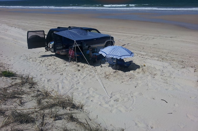Another group set up for the day in the soft sand areas and adjacent to the dunes. This is not a permitted activity in the Terms and Conditions that this permit holder would have signed